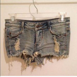 Distressed light wash denim shorts. Size 1.